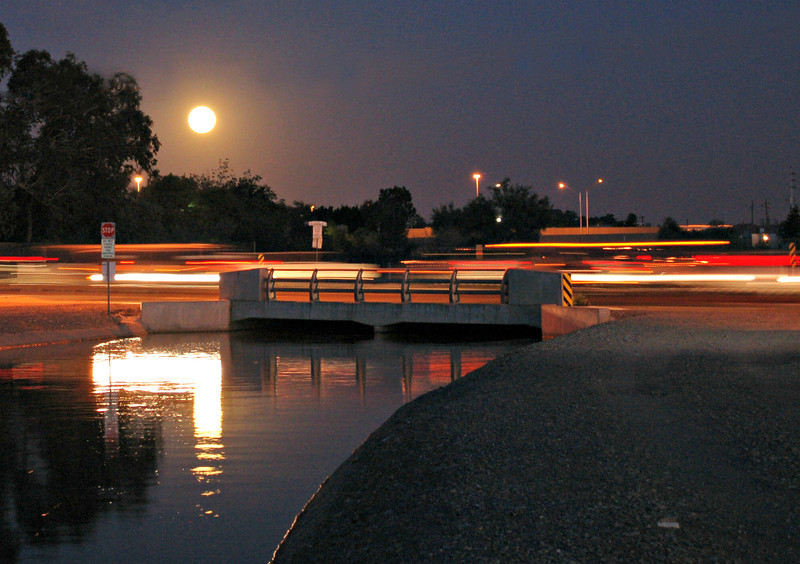 Full moon over the canal. You can see the light trails of the cars on Glendale Avenue.