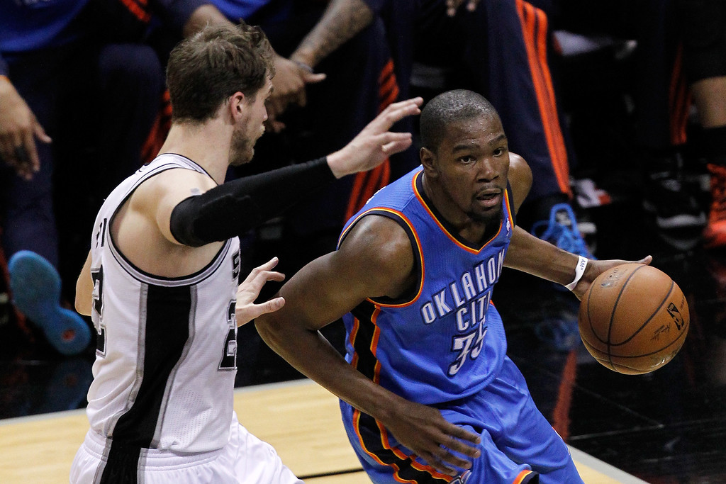 . Kevin Durant #35 of the Oklahoma City Thunder drives on Tiago Splitter #22 of the San Antonio Spurs in the first half in Game Two of the Western Conference Finals during the 2014 NBA Playoffs at AT&T Center on May 21, 2014 in San Antonio, Texas.   (Photo by Chris Covatta/Getty Images)