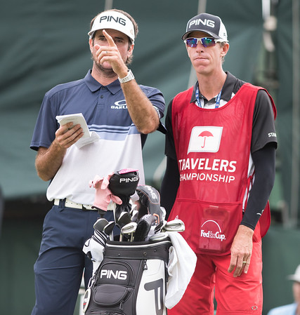 06/24/18 Wesley Bunnell   Staff The final day of The Travelers Championship at TPC River Highlands in Cromwell on Sunday June 24. Tournament Champion Bubba Watson speaks with his caddie on the 18th tee would win with a -17.