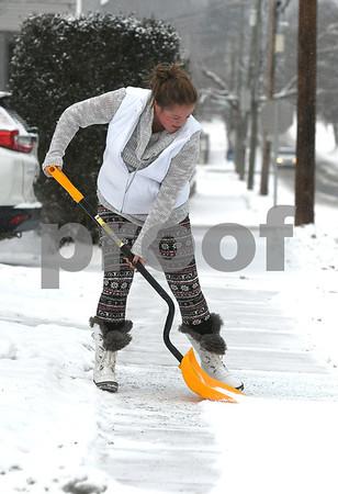12/30/2017 Mike Orazzi | Staff Lisa Kawecki while shoveling snow from a sidewalk along Carlton Street in New Britain Saturday.