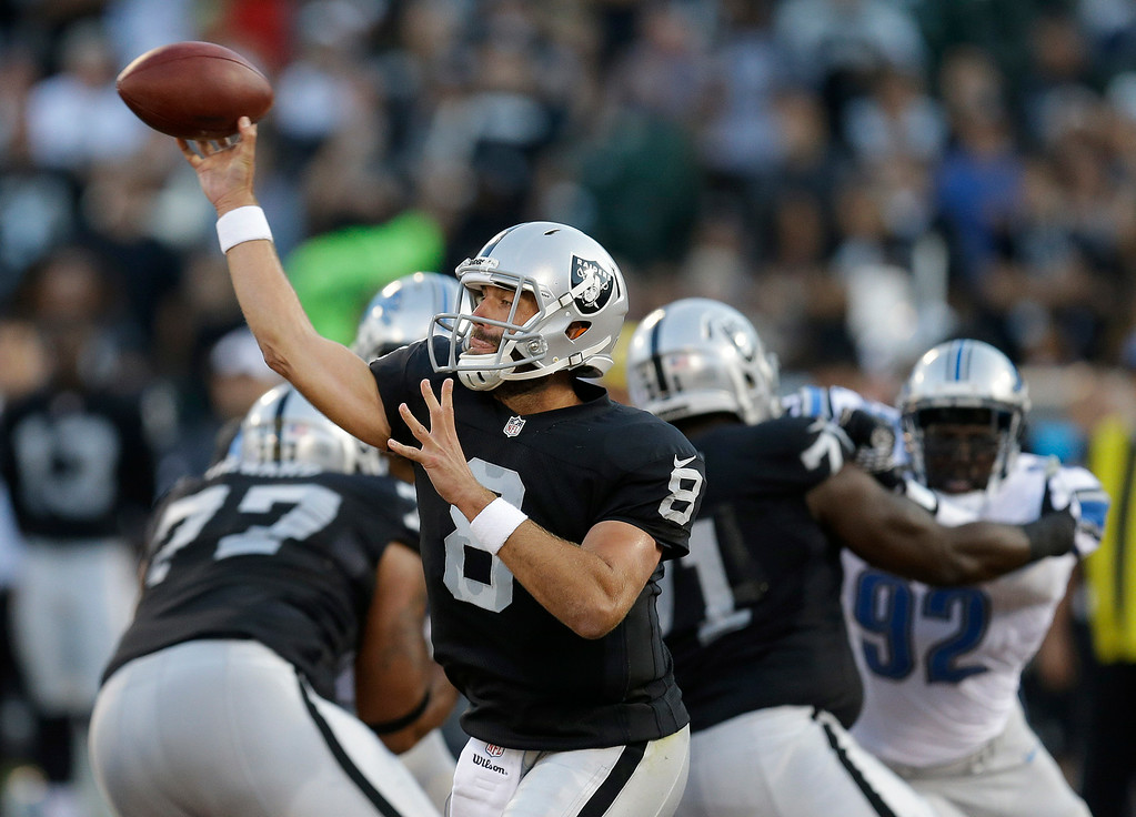 . Oakland Raiders quarterback Matt Schaub (8) passes against the Detroit Lions during the first quarter of an NFL preseason football game in Oakland, Calif., Friday, Aug. 15, 2014. (AP Photo/Ben Margot)