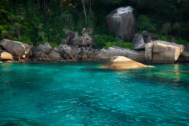 Koh Bon, Similan Islands - Thailand  The waters around the island of Koh Bon are nearly indescribable in their clarity and beauty. The jungle, the granite boulders stacked just so, the stunning azure blue of the water. It's almost as if it were a constructed stage for a movie.
