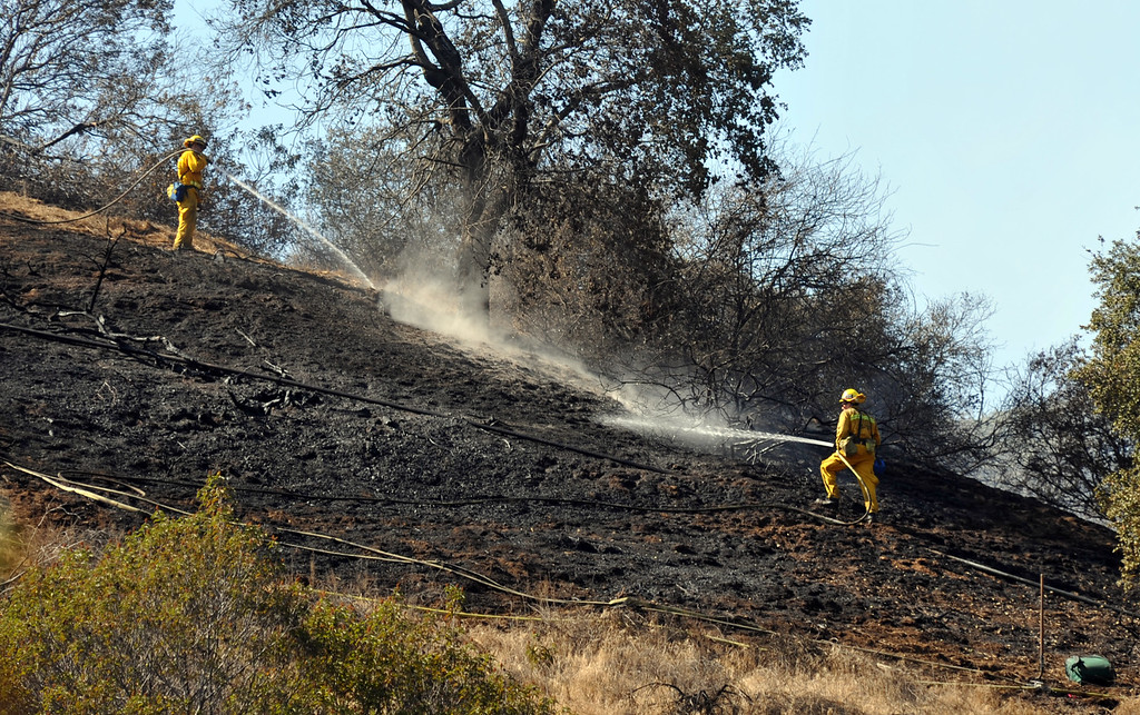 . Los Angeles County and La Verne Fire Department\'s work to extinguish a 6.9 acre brush fire in La Verne on Friday September 13, 2013.  (Whittier Daily News/Staff Photo by Keith Durflinger)