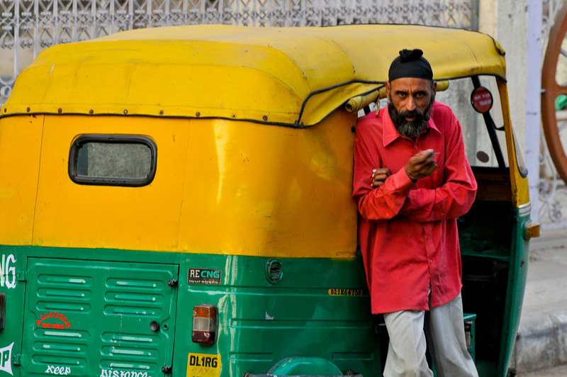 An autorickshaw. These are seen throughout India. The ones in Delhi are propelled by natural gas in an attempt to reduce air pollution.