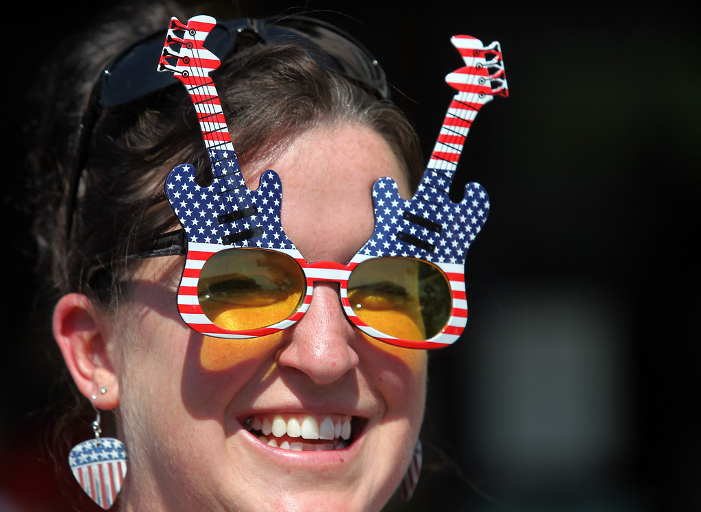 . Spectator Katie Menrath, who moved from Alaska to Alameda, sports patriotic glasses as she looks on during the Alameda Mayor\'s July 4th Parade on Park Street in Alameda, Calif., on Thursday, July 4, 2013. (Ray Chavez/Bay Area News Group)