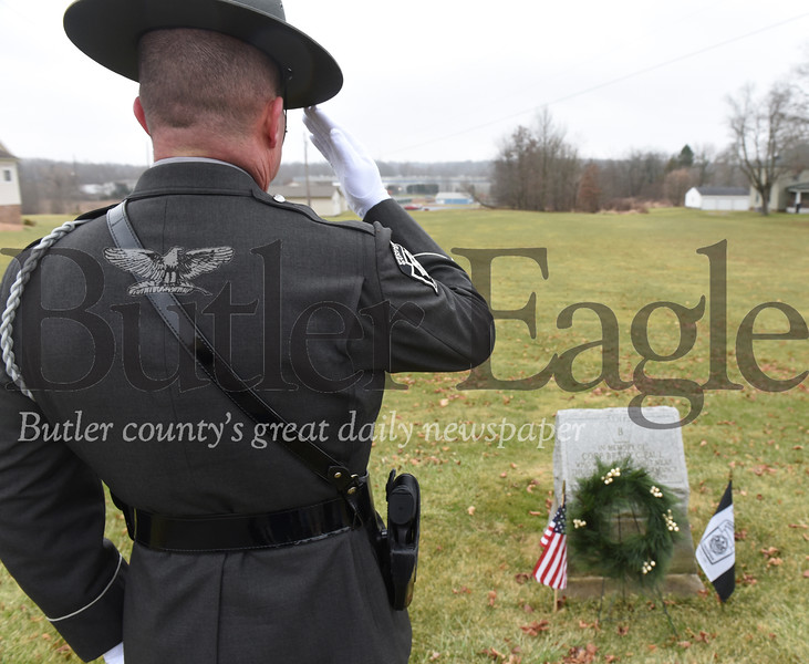 Harold Aughton/Butler Eagle:  Sergeant John Harold salutes during a memorial service held for PSP Corp. Brady C. Paul who was killed in the line of duty 90 years ago on December 27, 1929.