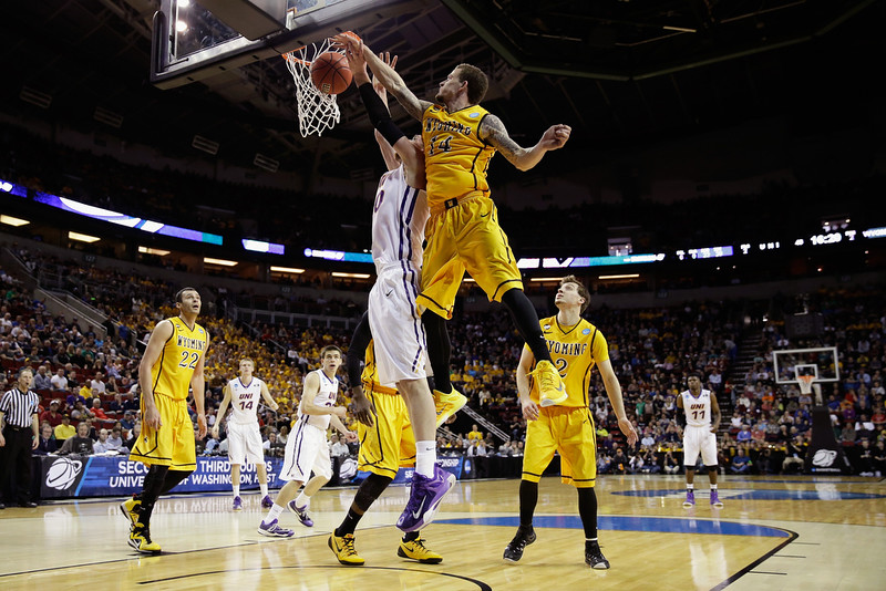 . Josh Adams #14 of the Wyoming Cowboys blocks a shot by Seth Tuttle #10 of the Northern Iowa Panthers during the second round of the 2015 Men\'s NCAA Basketball Tournament at KeyArena on March 20, 2015 in Seattle, Washington.  (Photo by Ezra Shaw/Getty Images)