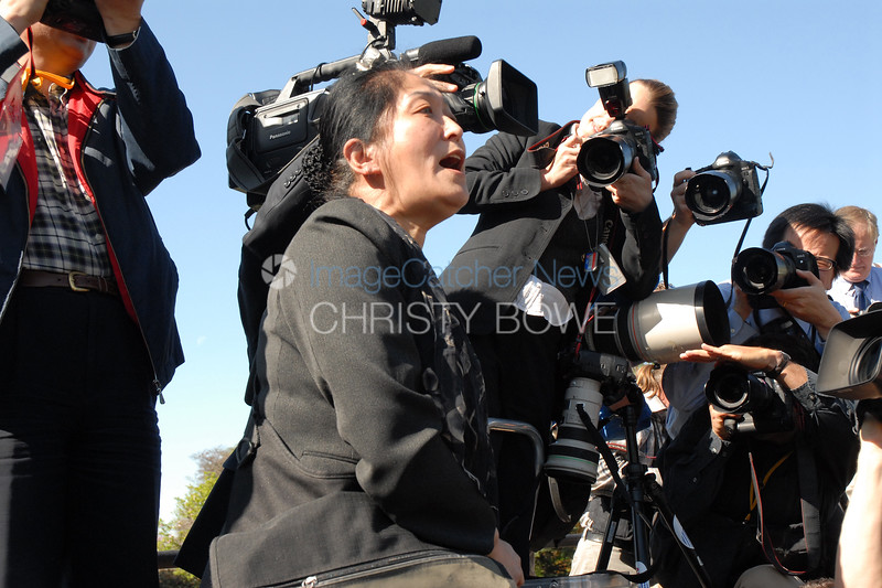 A protester begins screaming during the State Arrival Ceremony of The President of China.