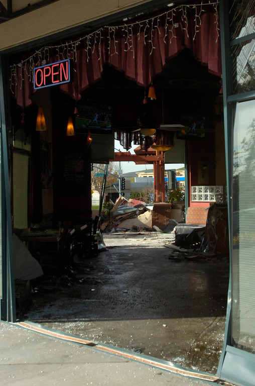 . The Strings Italian Cafe is left damaged after a Cadillac Escalade SUV was driven by accident through the restaurant during the lunch hour in Livermore, Calif., on Monday, Jan. 7, 2013. One customer was taken to a hospital for treatment of injuries and several other people sustained minor injuries. (Cindi Christie/Staff)