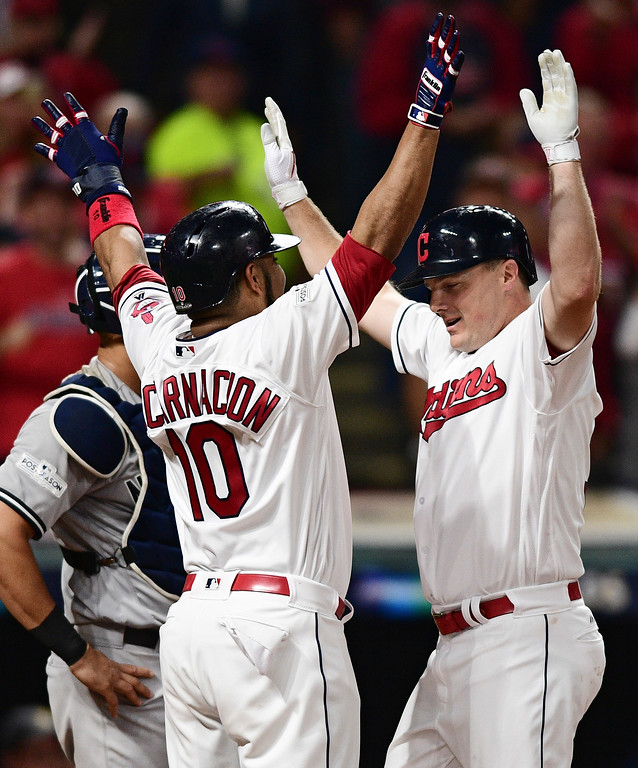 . Cleveland Indians\' Jay Bruce, right, is congratulated by Edwin Encarnacion after Bruce hit a two-run home run off New York Yankees starting pitcher Sonny Gray during the fourth inning of Game 1 of a baseball American League Division Series, Thursday, Oct. 5, 2017, in Cleveland. (AP Photo/David Dermer)