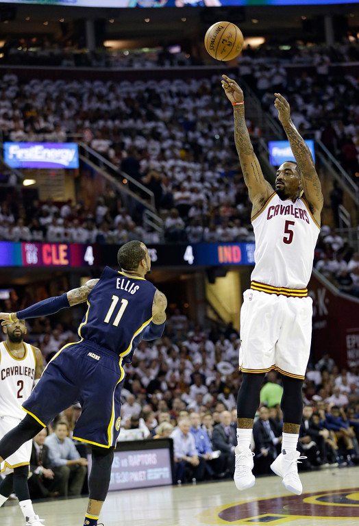 . Cleveland Cavaliers\' J.R. Smith (5) shoots over Indiana Pacers\' Monta Ellis, from France, in the first half in Game 1 of a first-round NBA basketball playoff series, Saturday, April 15, 2017, in Cleveland. (AP Photo/Tony Dejak)