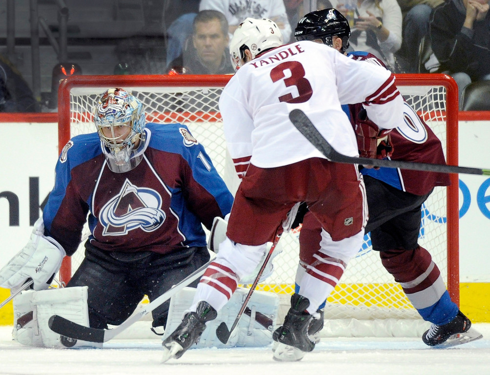 . Phoenix defenseman Keith Yandle (3) pressured Colorado goalie Semyon Varlamov (1) in the third period.    Photo By Karl Gehring/The Denver Post