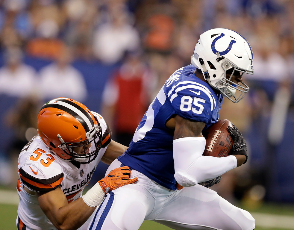 . Cleveland Browns middle linebacker Joe Schobert (53) tackles Indianapolis Colts tight end Brandon Williams (85) during the first half of an NFL football game in Indianapolis, Sunday, Sept. 24, 2017. (AP Photo/Darron Cummings)