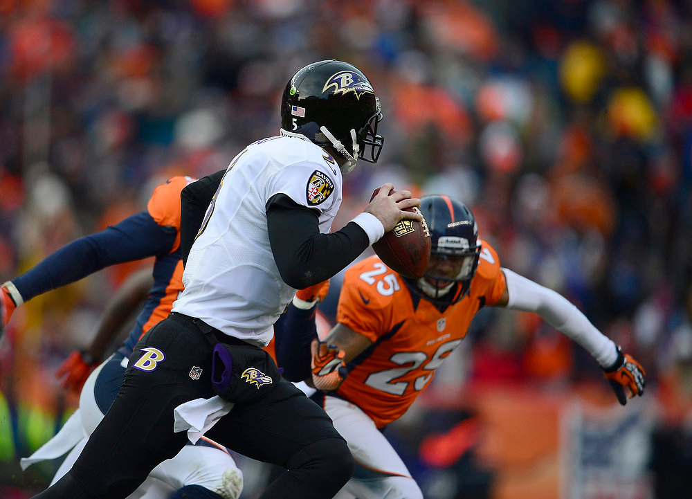 Description of . Baltimore Ravens quarterback Joe Flacco (5) scrambles from the pocket in the second quarter. The Denver Broncos vs Baltimore Ravens AFC Divisional playoff game at Sports Authority Field Saturday January 12, 2013. (Photo by AAron  Ontiveroz,/The Denver Post)