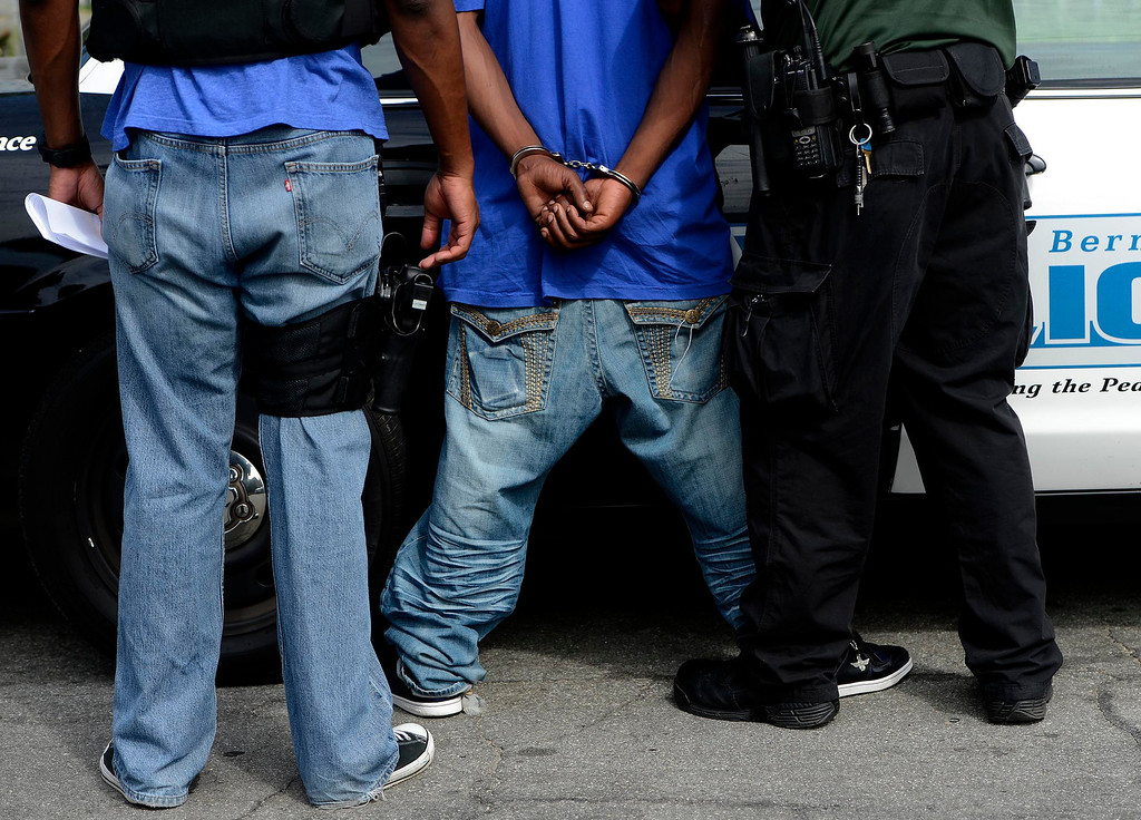 . An unidentified suspect is arrested by a San Bernardino Police officer during a SMASH sweep along the 1100 block Mayfield Drive in San Bernardino April 4, 2013.  GABRIEL LUIS ACOSTA/STAFF PHOTOGRAPHER.