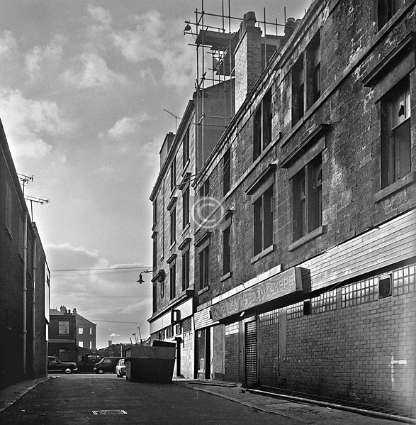 Ewing Place.  Last turning on the left off the Gallowgate before Parkhead Cross. Seems to be called Wellington Lane now. The corner tenement has survived.   February 1976
