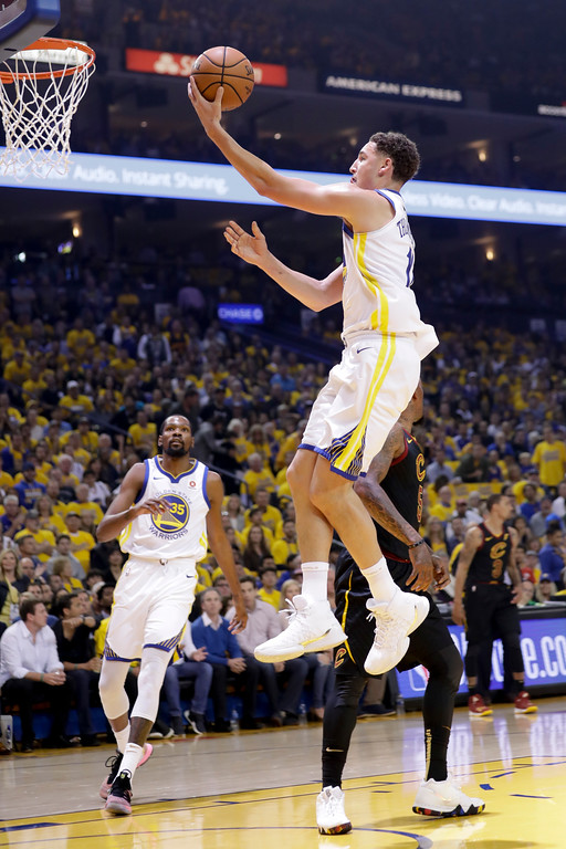 . Golden State Warriors guard Klay Thompson shoots against the Cleveland Cavaliers during the first half of Game 1 of basketball\'s NBA Finals in Oakland, Calif., Thursday, May 31, 2018. (AP Photo/Marcio Jose Sanchez)