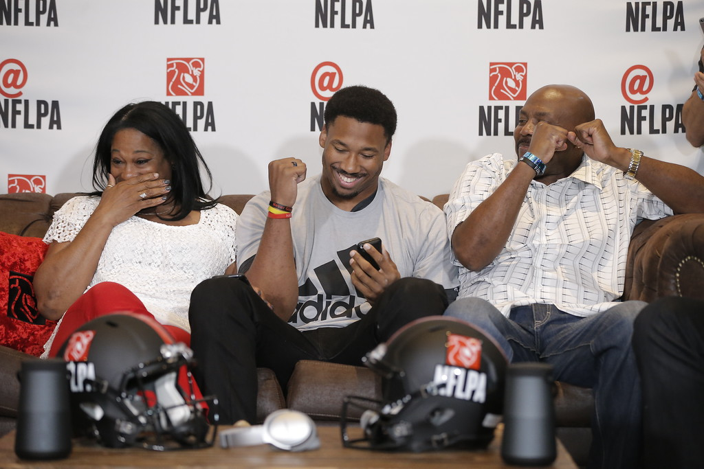 . IMAGE DISTRIBUTED FOR FOR NFLPA - Myles Garrett celebrates alongside his mother Audrey (left) and father Lawrence (right) after being chosen as the No. 1 overall pick by the Cleveland Browns while at the NFL Players Association\'s Myles Garrett Draft Day party at Terra Verde on Thursday, April 27, 2017, in Arlington, Texas. (Brandon Wade/AP Images for NFLPA)