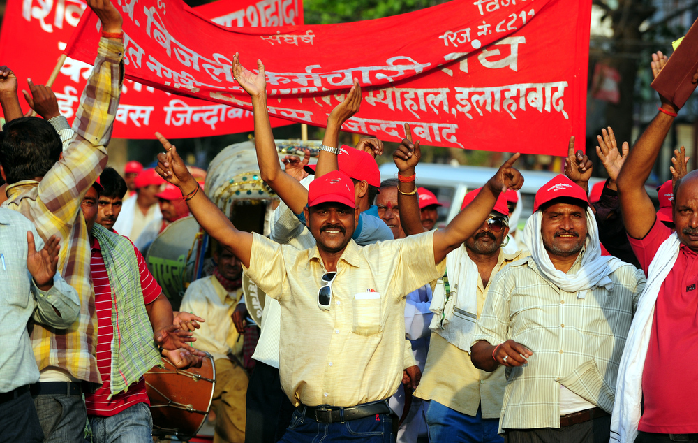 Description of . Activists of the All India Central Council of Trade Unions (AICCTU) participate in a May Day rally in Allahabad on May 1, 2013.  Workers from various labour groups took to the streets on the occasion of the International Labour Day which is observed worldwide.  Sanjay Kanojia/AFP/Getty Images