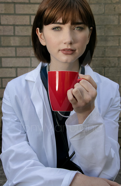 Portrait of beautiful female doctor, looking at camera