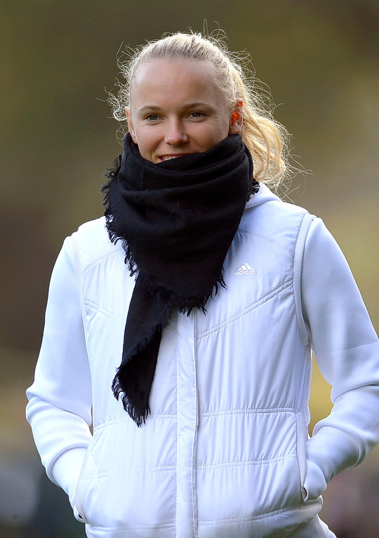 . Tennis player Caroline Wozniacki bundles up while following boyfriend Rory McIlroy during the second round of the Northwestern Mutual World Challenge golf tournament at Sherwood Country Club, Friday, December 6, 2013, in Thousand Oaks, Calif. Woods finished with a 10-under 62 and now leads the tournament by 2 strokes.(Andy Holzman/Los Angeles Daily News)
