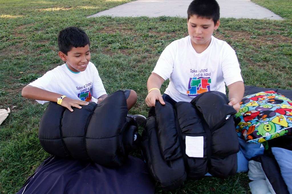 . IDB-L-Pom-Campout-02 (Correspondent Photo by James Carbone) Joseph Diaz, 10, left, and Joseph Barajas, 10, roll up their sleeping bags, during the 2013 GREAT Camp Out, at the Park Square area at the Pomona Fairplex, in Pomona, Saturday, July 13, 2013. The Event organized by the Pomona Police Department provides an opportunity for kids to interact with police officers in a positive environment.