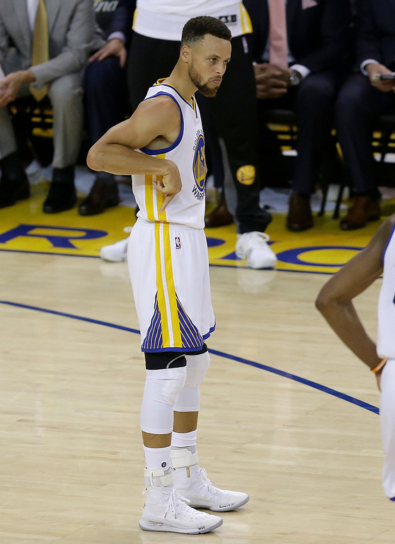 . Golden State Warriors guard Stephen Curry (30) gestures after scoring against the Cleveland Cavaliers during the second half of Game 2 of basketball\'s NBA Finals in Oakland, Calif., Sunday, June 4, 2017. (AP Photo/Ben Margot)