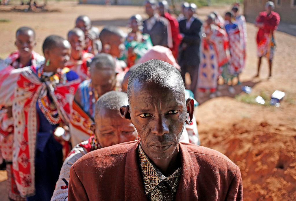 . Masai wait to cast ballot papers outside a polling station during the presidential and parliamentary elections near town of Magadi some 85 km (53 miles) south of Nairobi. REUTERS/Goran Tomasevic