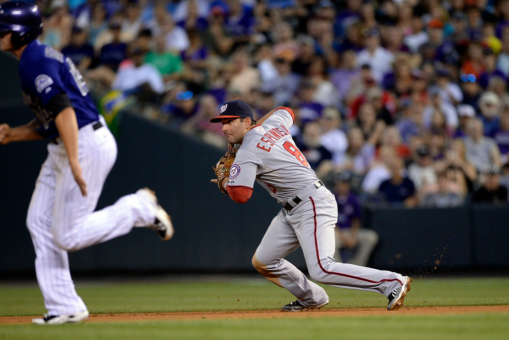. Danny Espinosa (8) of the Washington Nationals gets a force out on Josh Rutledge (14) of the Colorado Rockies at Coors Field. Major League Baseball action between the Colorado Rockies and the Washington Nationals on Monday, July 21, 2014. (Photo by AAron Ontiveroz/The Denver Post)