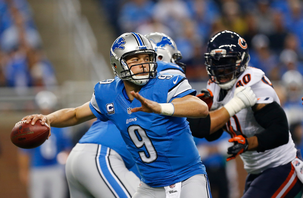 . Detroit Lions quarterback Matthew Stafford (9) throws during the first quarter of an NFL football game against the Chicago Bears at Ford Field in Detroit, Sunday, Sept. 29, 2013. (AP Photo/Paul Sancya)