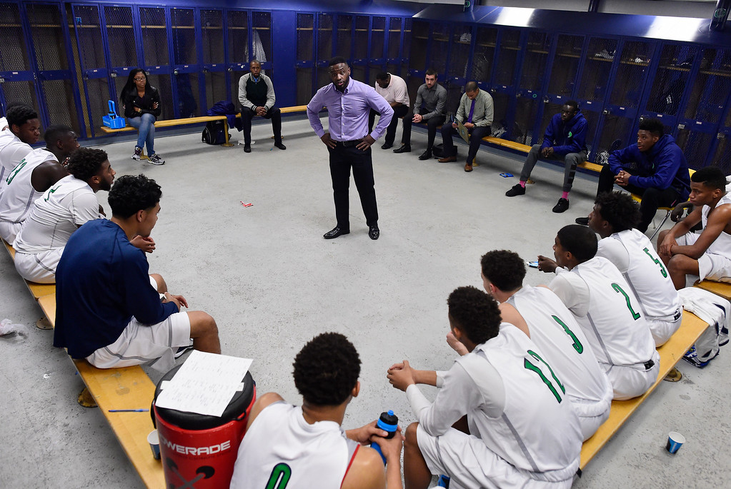 . head coach Danny Fisher of Overland speaks to his team after the first half of play. The Overland Trailblazers hosted the Eaglecrest Raptors on Friday, January 8, 2016. (Photo by AAron Ontiveroz/The Denver Post)