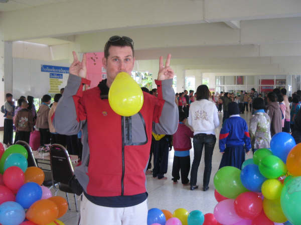 Helping inflate balloons