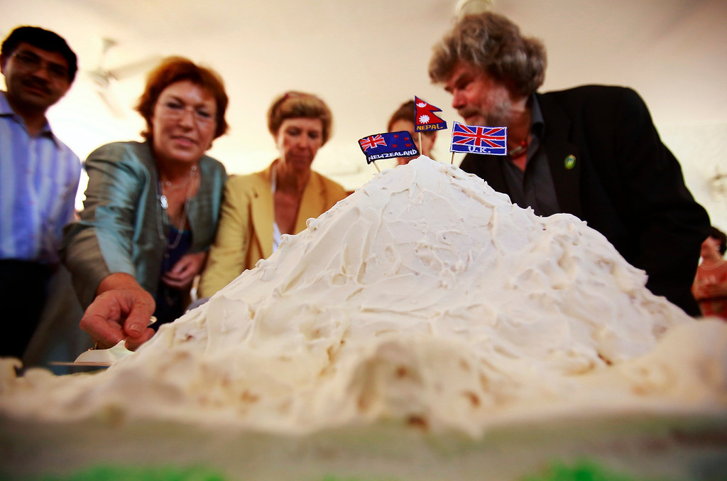 . A cake in the shape of Mount Everest is pictured during a program organized at the British Embassy of Nepal to mark the 60th anniversary of Sir Edmund Hillary and Tenzing Norgay Sherpa\'s conquest of Mount Everest in Kathmandu May 29, 2013. REUTERS/Navesh Chitrakar (NEPAL - Tags: ANNIVERSARY SOCIETY FOOD)