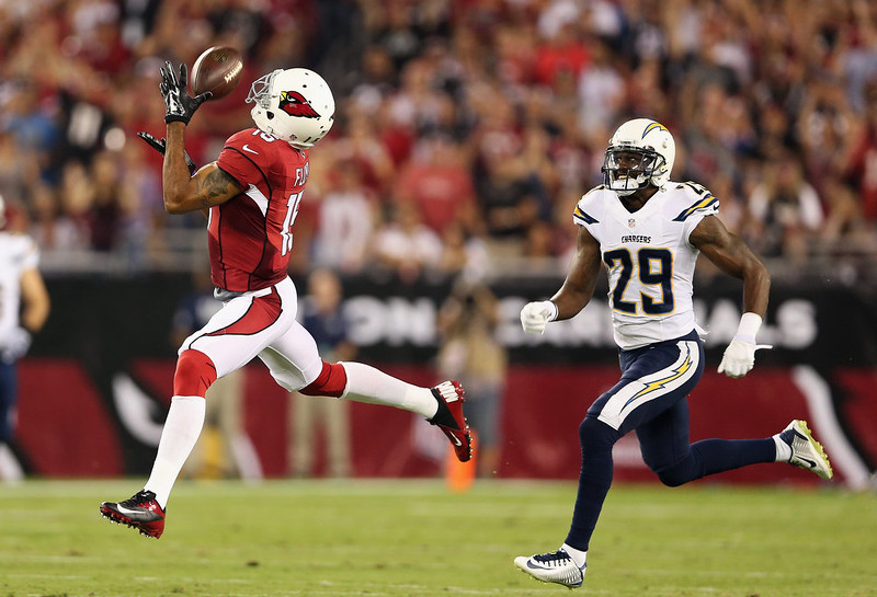 . Wide receiver Michael Floyd #15 of the Arizona Cardinals makes a 63 yard reception past cornerback Shareece Wright #29 of the San Diego Chargers in the first quarter of the NFL game at the University of Phoenix Stadium on September 8, 2014 in Glendale, Arizona.  (Photo by Christian Petersen/Getty Images)