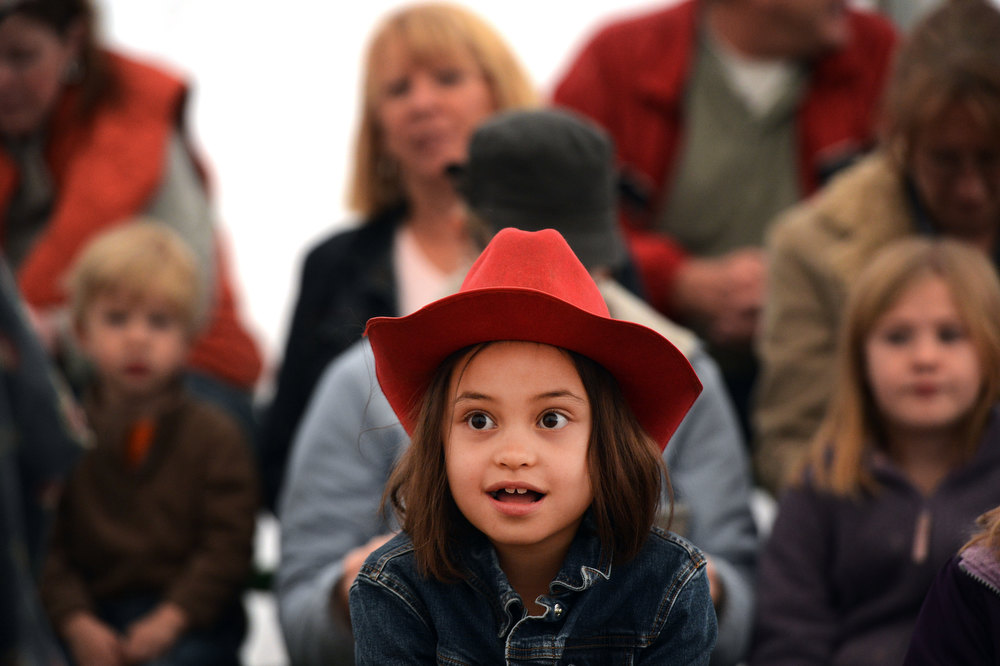 """. Angelina McCartney, 7, enjoys a performance by Duane Reichert in his one man act, Backstage with a Rodeo Clown, at the National Western Stock Show in Denver, CO, January, 26, 2013. Reichert says he\'s been a rodeo clown for 5 decades and started at age 19. Reichert used to get an adrenaline rush protecting cowboys from bulls he said, \""""now I get the same rush from making people laugh.\""""  (Photo By Craig F. Walker / The Denver Post)"""