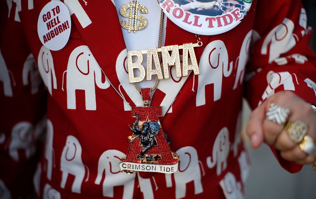 . An Alabama Crimson Tide fan shows his outfit outside Sun Life stadium before the BCS National Championship college football game between Alabama and the Notre Dame Fighting Irish in Miami, Florida January 7, 2013. REUTERS/Mike Segar
