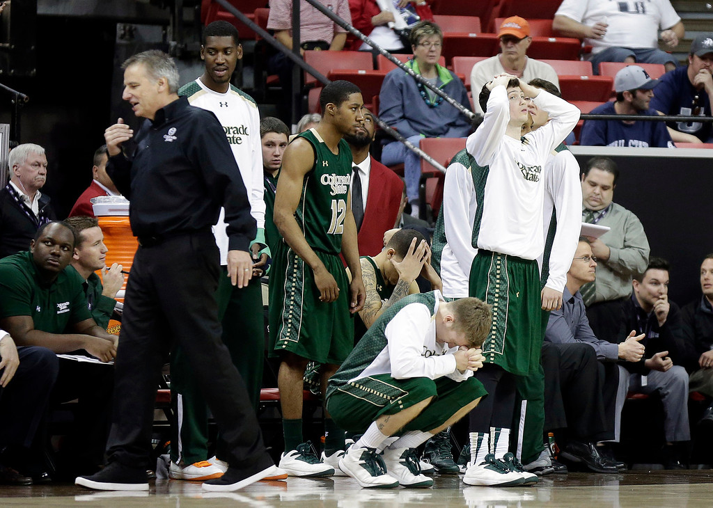 . Colorado State\'s bench reacts after a missed shot during the final moments of the second half of a Mountain West Conference tournament NCAA college basketball game against Utah State Wednesday, March 12, 2014, in Las Vegas. Utah State defeated Colorado State 73-69. (AP Photo/Isaac Brekken)