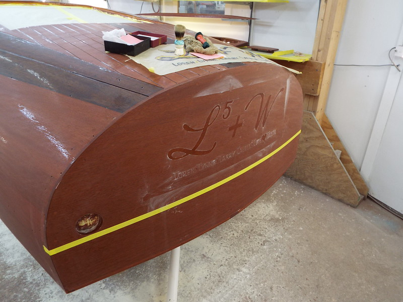Gold leaf sizing applied to the transom.