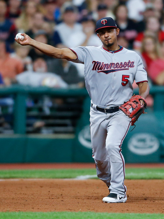 . Minnesota Twins\' Eduardo Escobar throws to first base and is charged with an error on a ball hit by Cleveland Indians\' Jay Bruce, which allowed Austin Jackson to score during the fifth inning in a baseball game, Wednesday, Sept. 27, 2017, in Cleveland. (AP Photo/Ron Schwane)