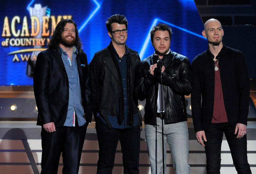 . From left, James Young, Chris Thompson, Mike Eli and Jon Jones, of musical group Eli Young Band, speak on stage at the 48th Annual Academy of Country Music Awards at the MGM Grand Garden Arena in Las Vegas on Sunday, April 7, 2013. (Photo by Chris Pizzello/Invision/AP)