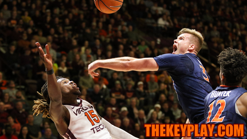 UVA's Jack Salt swats away a Chris Clarke floater attempt. (Mark Umansky/TheKeyPlay.com)
