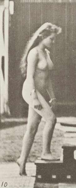 Nude woman turning and ascending stairs