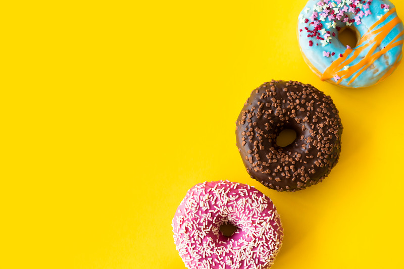 yummy-donuts-on-yellow-background-picjumbo-com.jpg