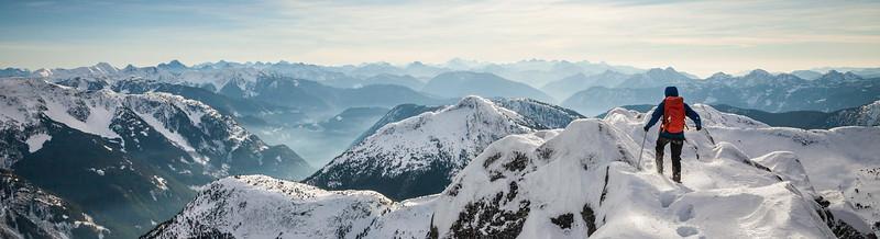 A climber walks towards the snowy summit of Needle Peak in the Coquihalla Recreation Area, British Columbia, Canada.