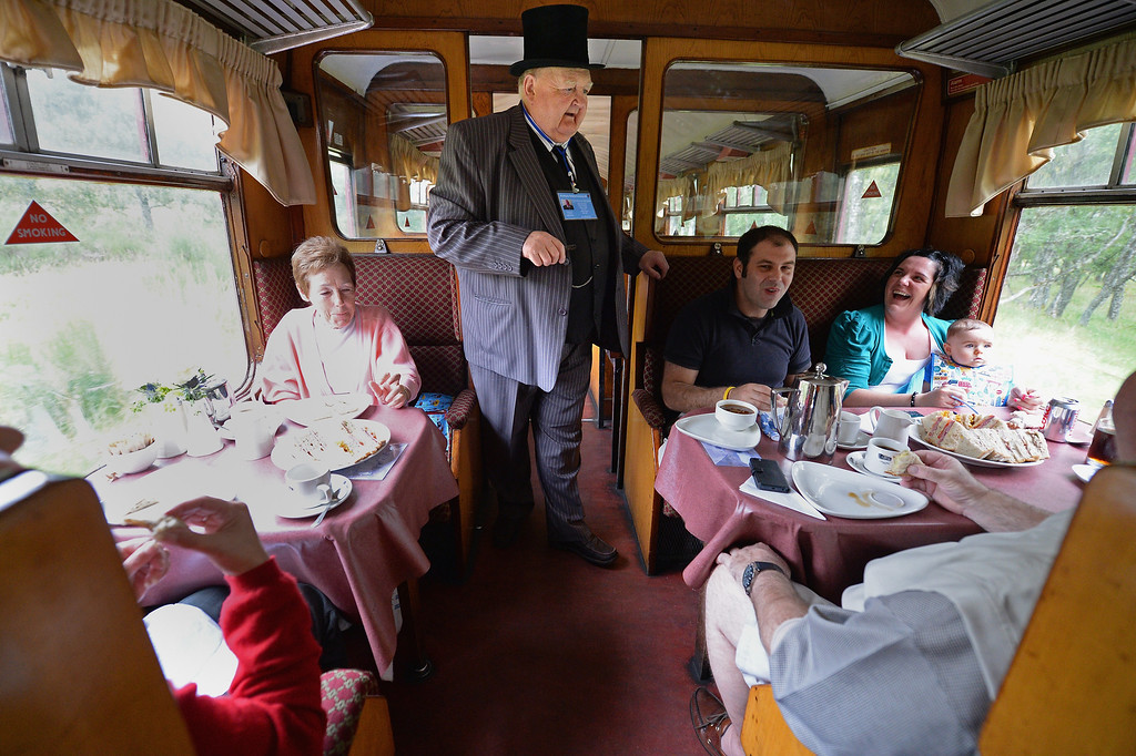 . Lionel Smith collects tickets on the 1952 British Rail Ivatt number 46512 at Strathspey Steam Railway on August 27, 2013 in Aviemore,Scotland.   (Photo by Jeff J Mitchell/Getty Images)