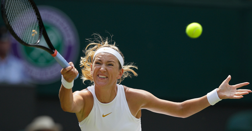 . Victoria Azarenka, of Belarus, returns the ball to Czech Republic\'s Karolina Pliskova, during their women\'s singles match, on the third day of the Wimbledon Tennis Championships, in London, Wednesday July 4, 2018. (AP Photo/Kirsty Wigglesworth)