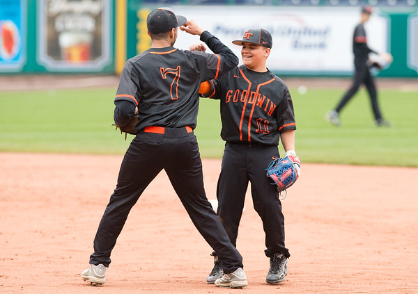 05/01/19 Wesley Bunnell | Staff Goodwin Tech baseball was defeated by Prince Tech on Wednesday evening at Dunkin Donuts Park in Hartford. Diajeh McCall (7) congratulates Isaac Cortes (11) on a good play.