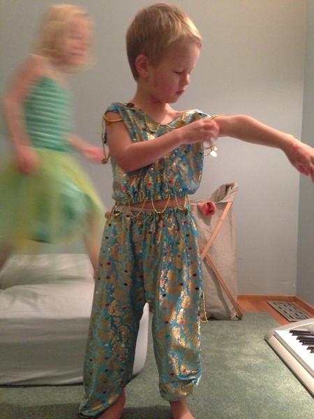 Connor in Amelia's belly dancing suit