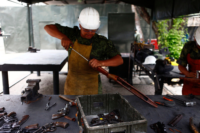 . A soldier destroys a shotgun confiscated by national security authorities at a military zone of Mexico City April 17, 2013. The military is in charge of storing and destroying weapons, not only those handed in by the civilian population sometimes including those inherited from an ancestor who might have fought in the revolution but also the weapons confiscated in the six-year-long, ongoing drug war that has so far killed some 70,000 people. Picture taken April 17, 2013. REUTERS/Edgard Garrido