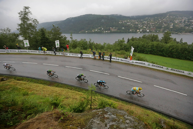 . The pack with Italy\'s Vincenzo Nibali, wearing the overall leader\'s yellow jersey, speeds downhill during the eighth stage of the Tour de France cycling race over 161 kilometers (100 miles) with start in Tomblaine and finish in Gerardmer, France, Saturday, July 12, 2014. (AP Photo/Laurent Cipriani)